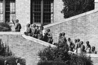 "Soldiers from the 101st Airborne Division escort the ""Little Rock Nine"" students into the all-white Central High School"