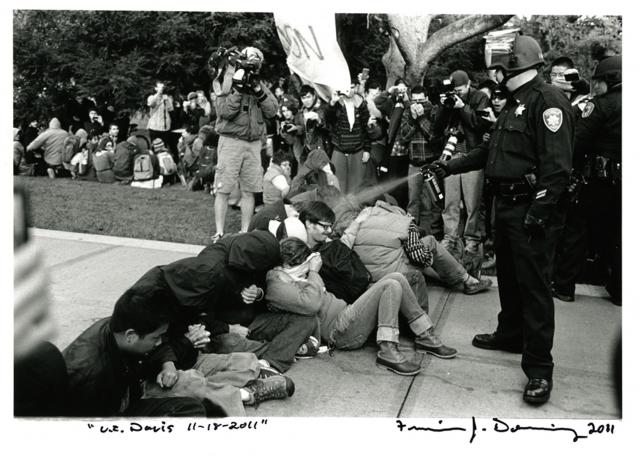 University of California Davis police officer assaults students with pepper spray. ©2011 Francisco Dominguez