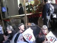 David Solnit chants for climate justice at sit-in at B of A, Nov. 30, 2009 (c) Jess Clarke