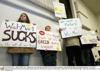 Opponents of a proposed Wal-Mart attend a local meeting. ©  2005 Gloria Wright / Syracuse Newspapers / The Image Works