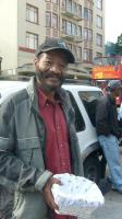 As a tourist bus passes a longtime Tenderloin resident asks for change.   © 2009 Christopher D. Cook