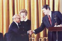 Milton Friedman congratulated by President Ronald Reagan.  2008 Free To Choose Media, courtesy of the Power of Choice press kit