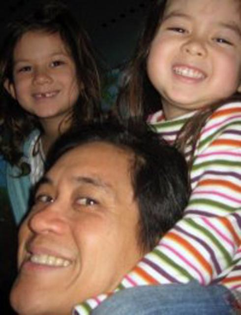 Penn Loh with his daughters, Nacie (left) and Thea (right).   2010  Jacquelyn Cefola